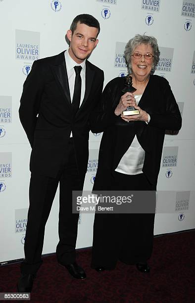 Margaret Tyzack poses with the Best Actress Award for The Chalk Garden presented by Russell Tovey during The Laurence Olivier Awards at The Grosvenor...