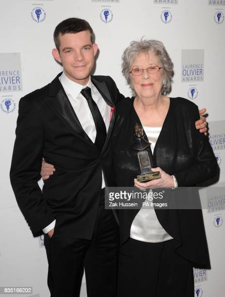 Margaret Tyzack wins the Best Actress Award presented by Russell Tovey during the Laurence Olivier Awards at the Grosvenor Hotel in central London