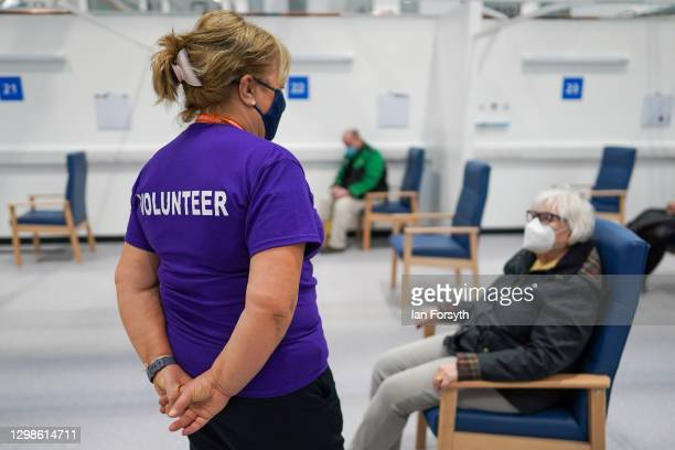 Margaret Wakefield from Langley Park speaks with a volunteer in the post vaccine observation area after receiving her AstraZeneca/Oxford University...