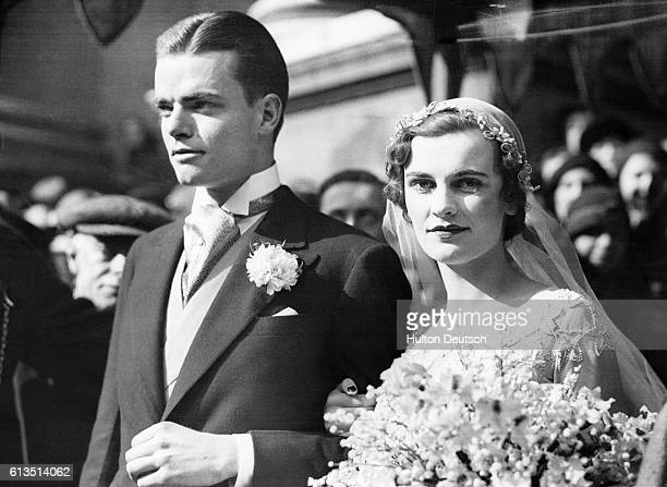 Margaret Whigham the Duchess of Argyll leaves Brompton Oratory with her husband Charles Sweeny after their marraige 1933