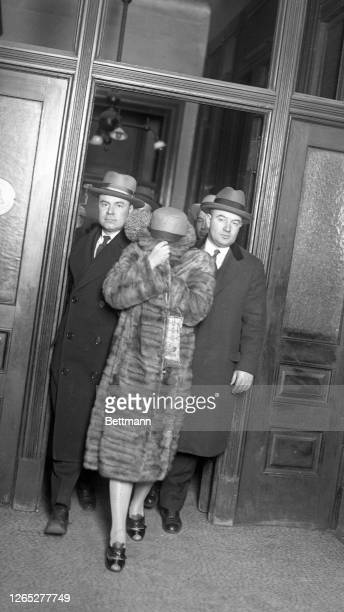 Margaret Whittemore, wife of the gang leader, leaving cirminal court after hearing the first degree robbery indictment brought against herself and...