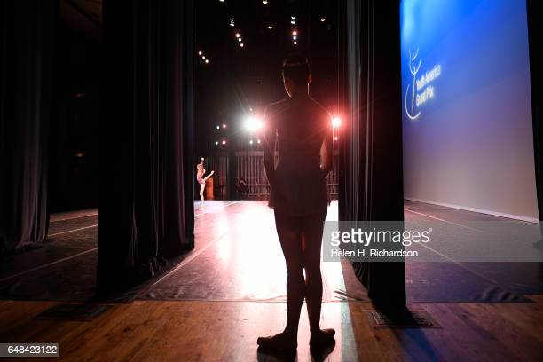 Margaret Whyte, of Helena, Montana, warms up backstage as she waits in the wings for her chance to perform during the 2017 during the Youth America...