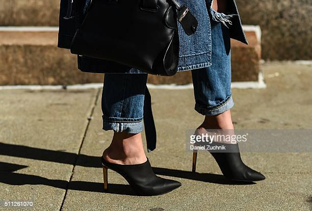 Margaret Zhang accessories detail is seen outside the Calvin Klein show wearing a jean coat during New York Fashion Week Women's Fall/Winter 2016 on...