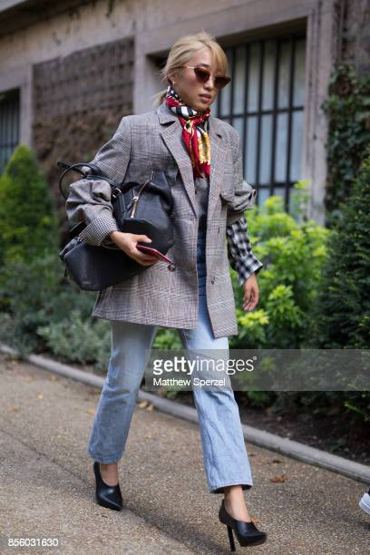 Margaret Zhang is seen attending Mugler during Paris Fashion Week wearing a grey blazer with scarf and jeans on September 30 2017 in Paris France
