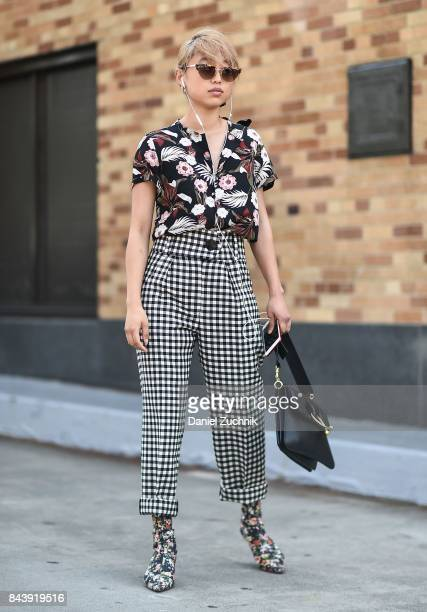 Margaret Zhang is seen wearing a floral top and black and white striped pants outside the Brock Collection during New York Fashion Week Women's S/S...