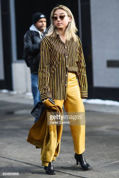 Margaret Zhang is seen wearing a mustard jacket and leather pants at the Dion Lee show during New York Fashion Week Women's Fall/Winter 2017 on...