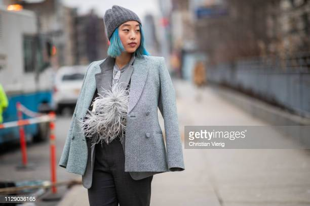 Margaret Zhang is seen wearing grey beanie, blazer outside Zimmermann during New York Fashion Week Autumn Winter 2019 on February 11, 2019 in New...