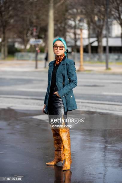 Margaret Zhang is seen wearing jacket, black skirt, overknees boots outside Chanel during Paris Fashion Week - Womenswear Fall/Winter 2020/2021 : Day...