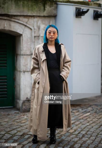 Margaret Zhang is seen wearing trench coat outside Vivienne Westwood during London Fashion Week February 2019 on February 17, 2019 in London, England.
