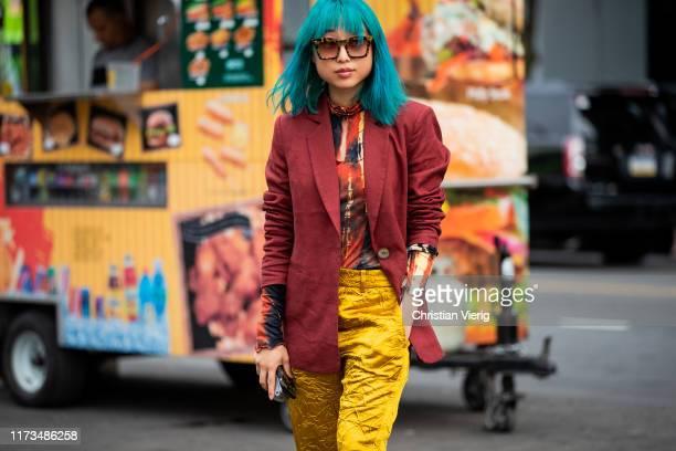 Margaret Zhang is seen wearing wearing red blazer, golden pants outside Carolina Herrera during New York Fashion Week September 2019 on September 09,...