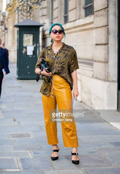 Margaret Zhang is seen wearing yellow pants, button shirt outside Ralph & Russo during Paris Fashion Week - Haute Couture Fall/Winter 2019/2020 on...