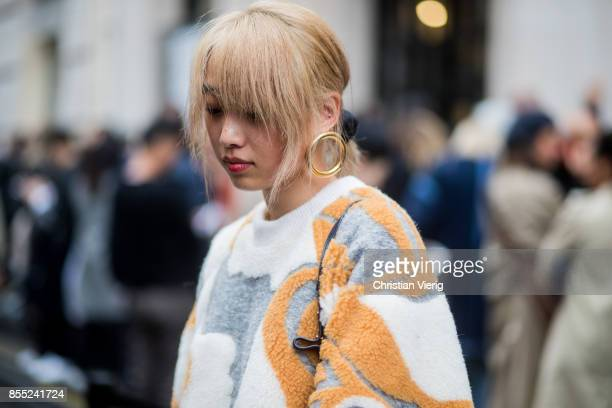 Margaret Zhang wearing golden earring is seen outside Chloe during Paris Fashion Week Spring/Summer 2018 on September 28 2017 in Paris France