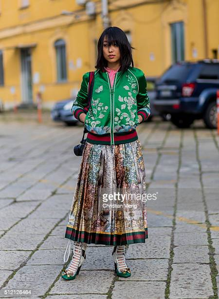 Margaret Zhang wearing Gucci jacket skirt and shoes seen outside Gucci during Milan Fashion Week Fall/Winter 2016/17 on February 24 2016 in Milan...