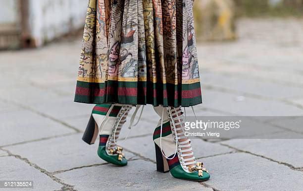 Margaret Zhang wearing Gucci skirt and shoes seen outside Gucci during Milan Fashion Week Fall/Winter 2016/17 on February 24 2016 in Milan Italy