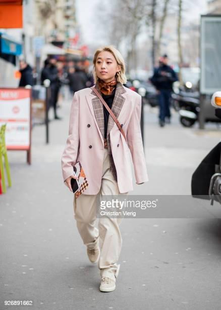 Margaret Zhang wearing Loewe bag, pastel blazer is seen outside Altuzarra during Paris Fashion Week Womenswear Fall/Winter 2018/2019 on March 3, 2018...