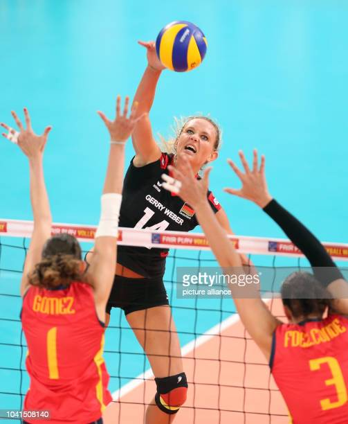 Margareta Anna Kozuch of Germany in action against Rocio Gomez Lopez and Maria Isabel Fernandez Conde of Spain during their women's CEV Volleyball...