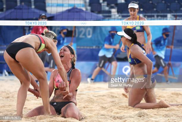 Margareta Kozuch and Laura Ludwig Team Germany react after defeating Agatha Bednarczuk and Eduarda Santos Lisboa of Team Brazil during the Women's...