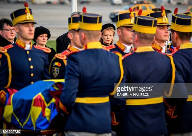 Margareta one of the daughters of King Michael I of Romania looks at the coffin of her father at Henry Coanda International airport in Otopeni city...