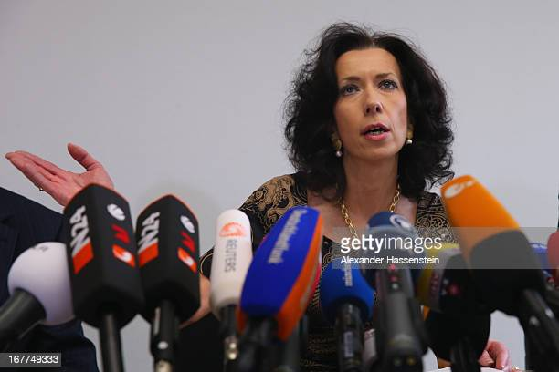 Margarete Noetzel head of the press department of the Oberlandgericht Muenchen court speaks to the media following the lottery draw for the 50 media...