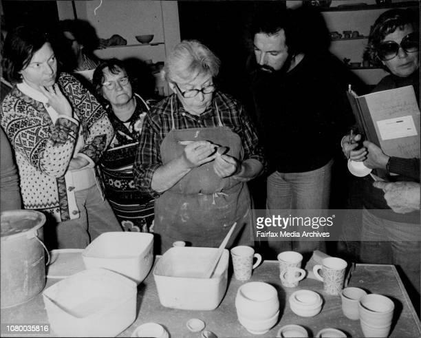 Margarete Schott glazing pots at the Potters Gallery Burton St Darlinghurst July 21 1978
