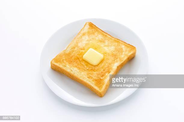 margarine melting on slice of toast - margarine stock pictures, royalty-free photos & images