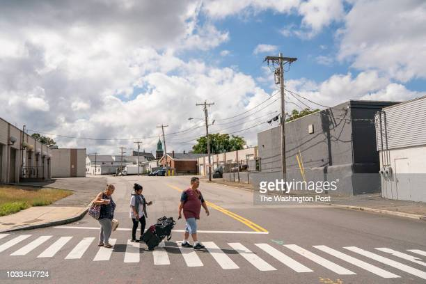 Margarita Anaya her granddaughter Shericksa Baez and Shericksa's father Carmelo Baez walk down Parker Street in Lawrence Mass as they evacuated the...