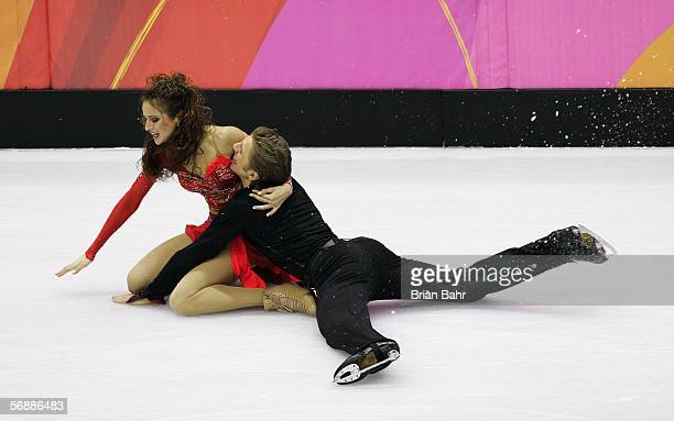 Margarita Drobiazko and Povilas Vanagas of Lithuania fall to to the floor as they perform during the Original Dance program of the figure skating...