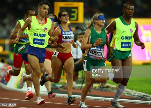 LR Margarita Faundez of Chile and Guida Francisco Munoz and Louzanne Coetzee of South Africa and Guida Voight Mikone compete Women's 1500m T11 Final...