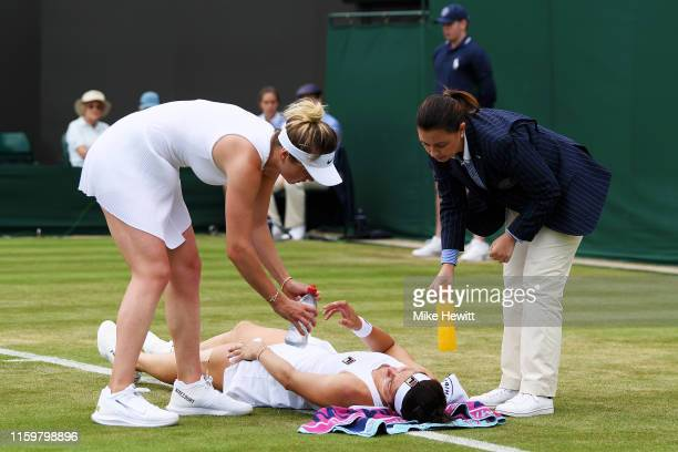 Margarita Gasparyan of Russia lies injured on the court in her Ladies' Singles second round match against Elina Svitolina of Ukraine during Day three...