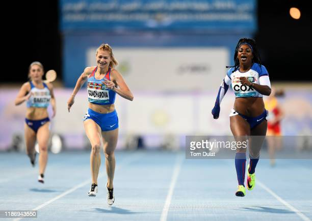 Margarita Goncharova of Russia and Kadeena Cox of Great Britain compete durin the Women's 400m T38 Final race on Day Five of the IPC World Para...