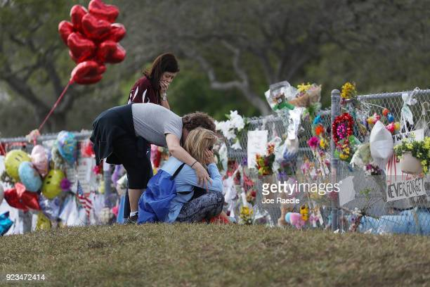 Margarita Lasalle the budget keeper and Joellen Berman Guidance Data Specialist and Holli Sutton visit the memorial in front of Marjory Stoneman...