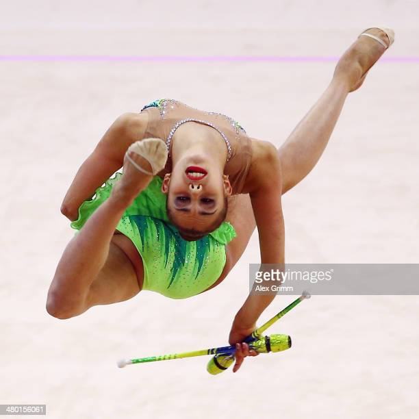 Margarita Mamun of Russia performs during the individual clubs final of the GAZPROM World Cup Rhythmic Gymnastics 2014 at the Porsche Arena on March...