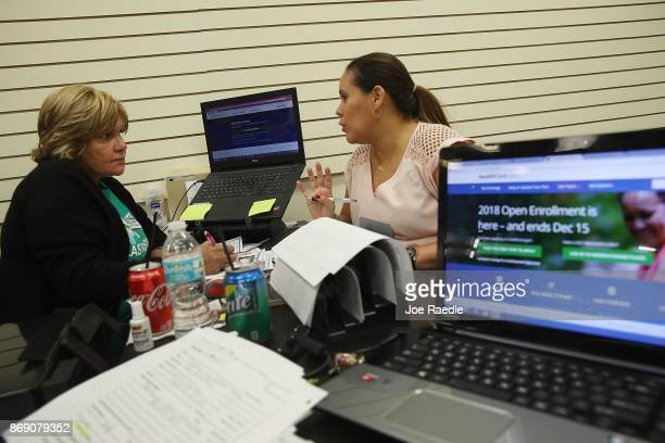 Margarita Mills , an insurance agent from Sunshine Life and Health Advisors, speaks with Daniela Morales as she shops for insurance under the...
