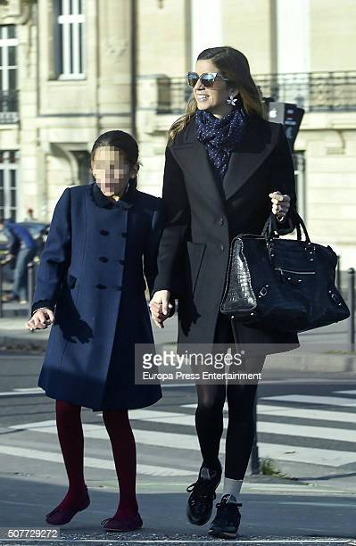Part of this image has been pixellated to obscure the identity of the child Margarita Vargas and her daughter Eugenia de Borbon are seen going for...
