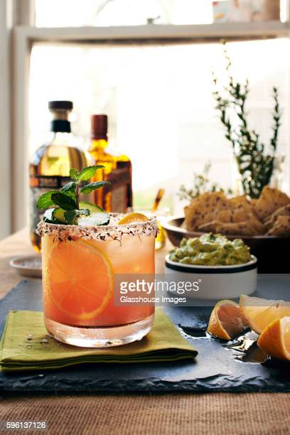 margarita with guacamole and chips - margarita stock pictures, royalty-free photos & images