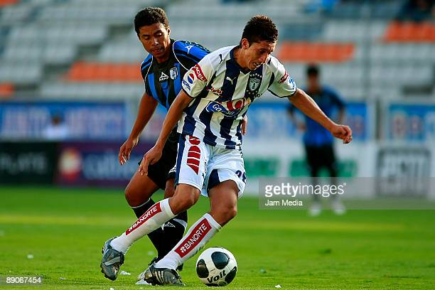Margarito Gonzalez of Queretaro vies for the ball with Hector Herrera of Pachuca during a Cuna del Futbol Tournament 2009 match at Hidalgo Stadium on...