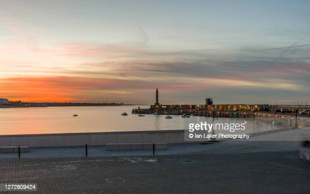 margate, kent, uk. 18 november 2012. the lighthouse and harbour arm at sunset. - harbour stock pictures, royalty-free photos & images