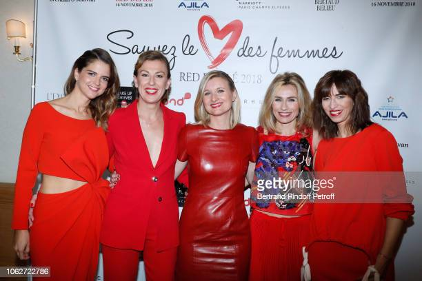 Margaux de Frouville Gaetane Meslin Karine de Menonville Sandra Larue and Candice Mahout attend the Sauvez le Coeur des Femmes Red Defile Show at...