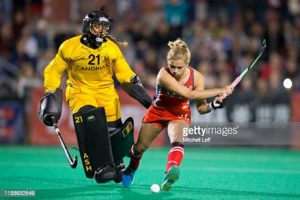 Margaux Paolino of United States shoots the ball against Aisling D'Hooghe of Belgium in the shoot out during the Women's FIH Field Hockey Pro League...