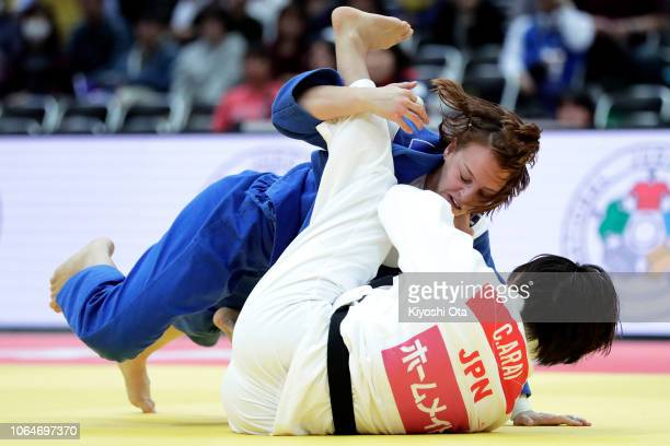 Margaux Pinot of France competes against Chizuru Arai of Japan in the Women's 70kg semifinal match on day two of the Grand Slam Osaka at Maruzen...