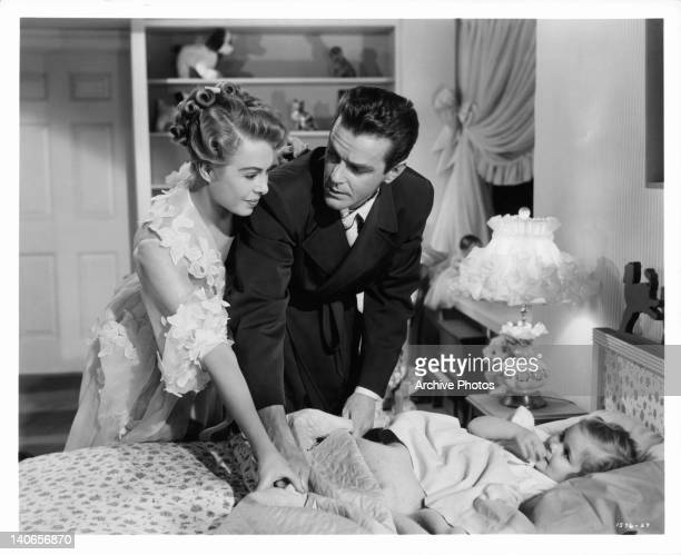 Marge Champion and Gower Champion say good night to their screen daughter Mimi Gibson in a scene from the film 'Everything I Have Is Yours' 1952