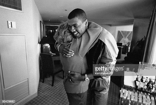 Marge Schott owner of the Cincinnati Reds baseball team getting an affectionate hug from her black baseball star Jose Rijo who is visiting w her in...
