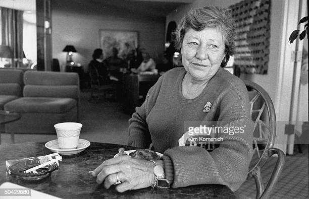 Marge Schott owner of the Cincinnati Reds baseball team sitting at table w coffee cigarette in ashtray in her hotel room