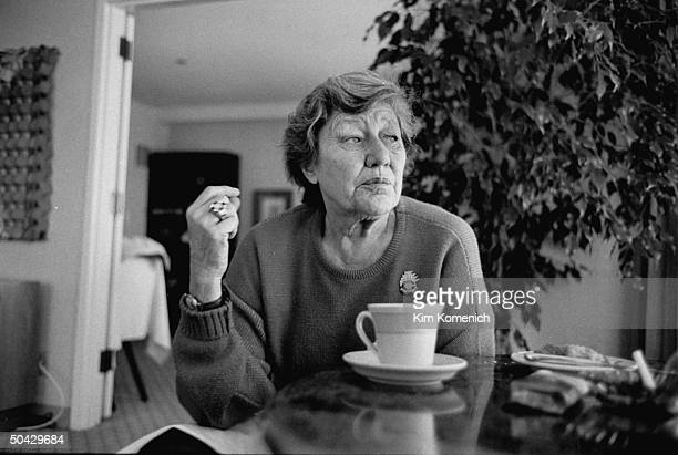 Marge Schott owner of the Cincinnati Reds baseball team sitting at table w cup of coffee in her hotel room