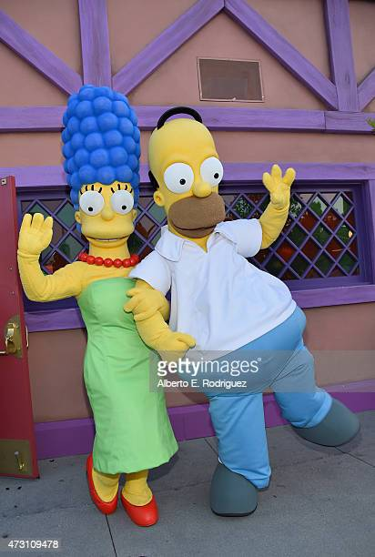Marge Simpson and Homer Simpson attend the Taste of Springfield press event at Universal Studios Hollywood on May 12 2015 in Universal City California