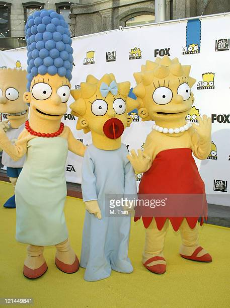 Marge Simpson Maggie Simpson and Lisa Simpson during The Simpsons 400th Episode Block Party at The FOX Lot New York Street in Los Angeles California...