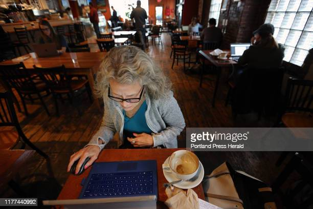 Marge Stockford of Portland works on her laptop on Friday at Arabica Coffee after finishing a cup of cappuccino Stockford chose the spot for its...