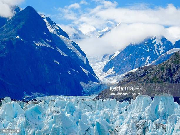 Margerie Glacier By Mountains Against Sky