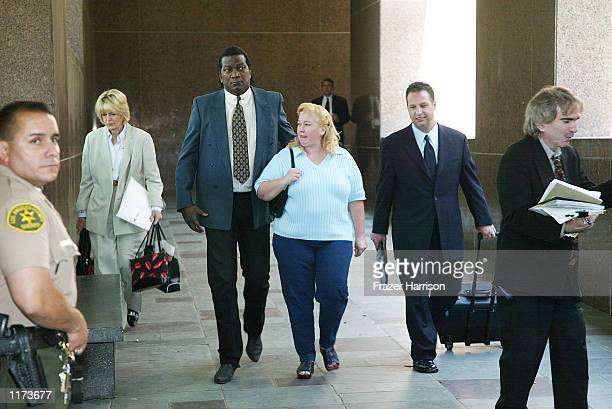 Margerry Bakley the sister of the late Bonny Lee Bakley exits Los Angeles Superior Court with her body guard and her attorney Eric J Dublin after a...