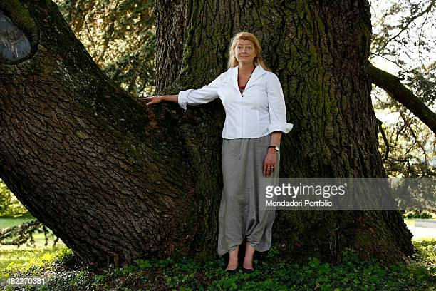 Margherita Agnelli de Pahlen posing in the garden of her villa at Lake Geneva leaning against the big trunk of a tree Allaman Switzerland June 26th...